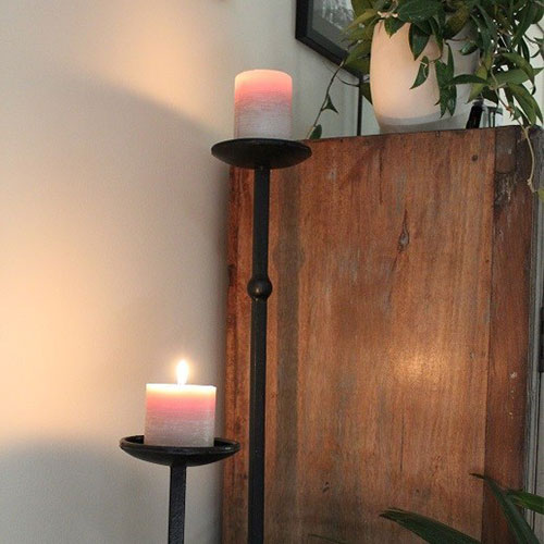 Candle stands with candles on them