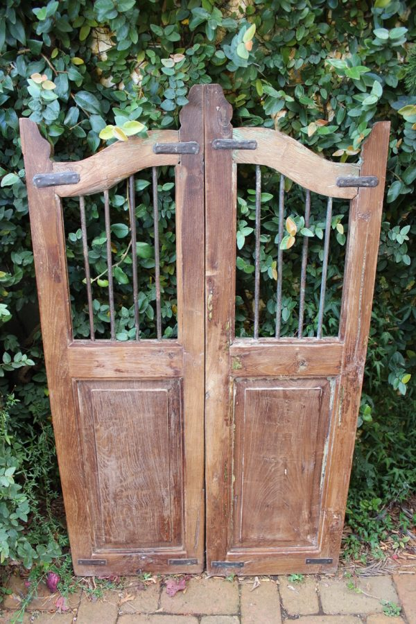 Wooden garden gate with vertical iron bars