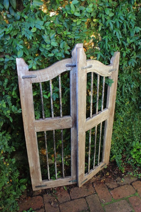 Wooden gate with creeping fig