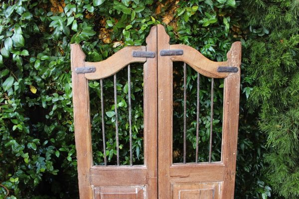 Timber gate and iron bars