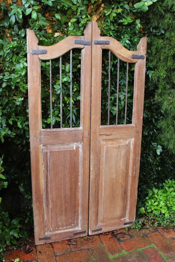 Timber gate with iron bars