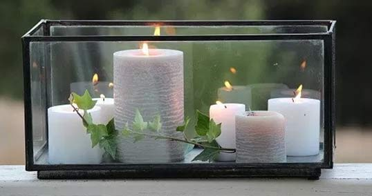 Glass display with candles inside