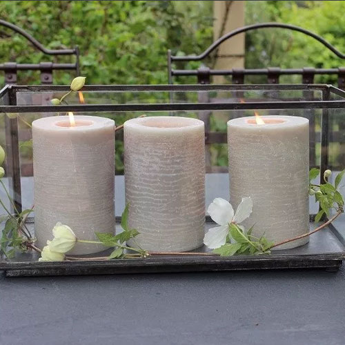 3 candles in a glass candle box