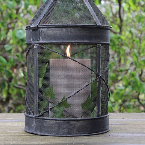 A lantern with a candle in it