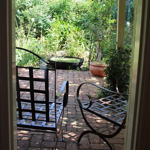 2 metal chairs in a garden