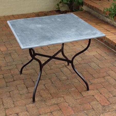 grey stone table with iron base base