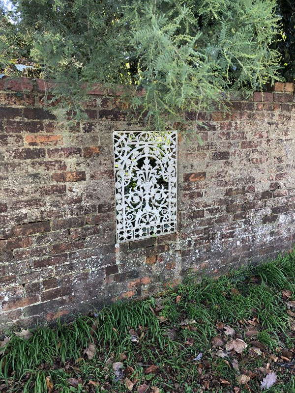 Brick wall with iron feature inset