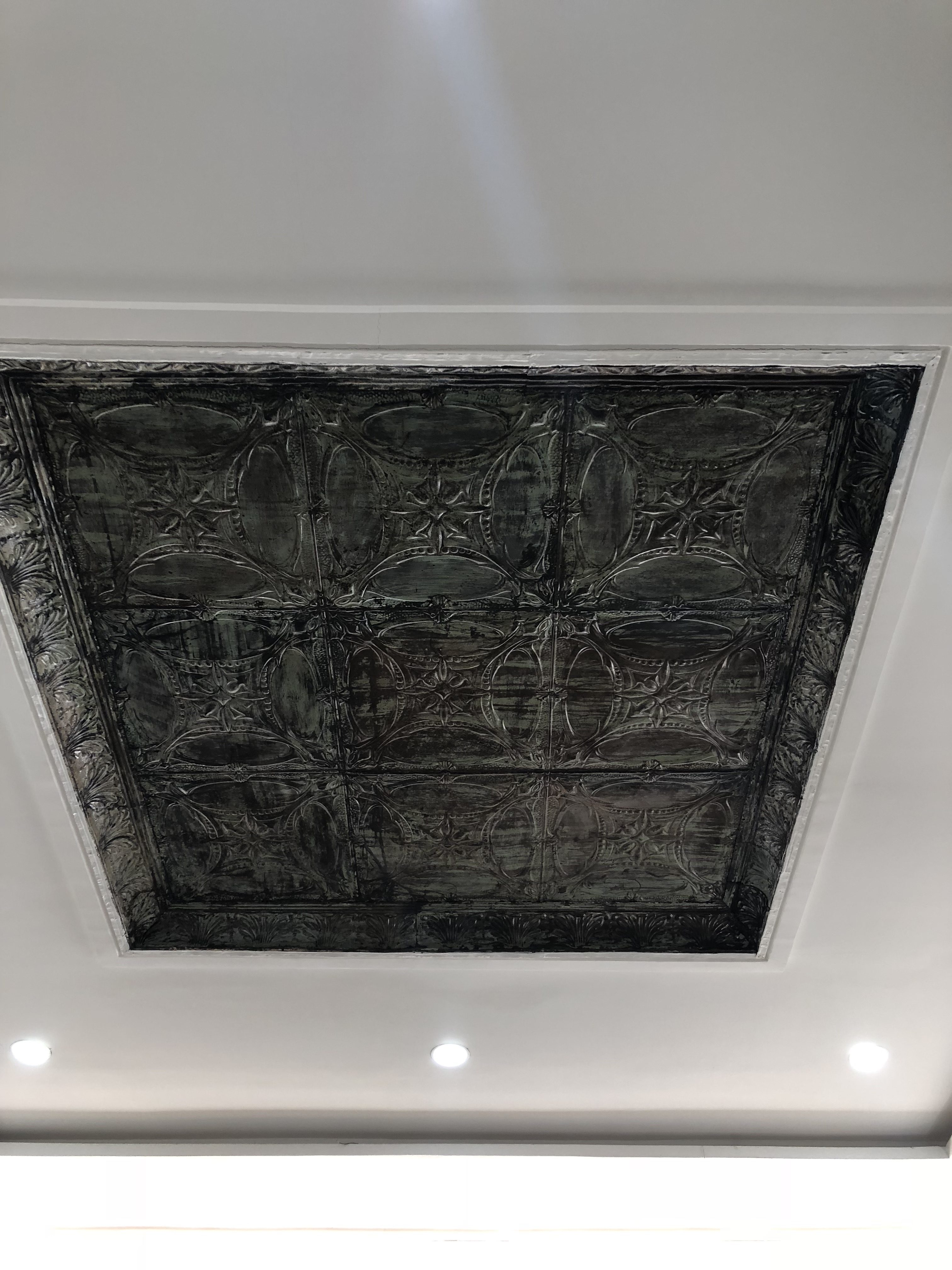 Pressed metal ceiling panel with downlights