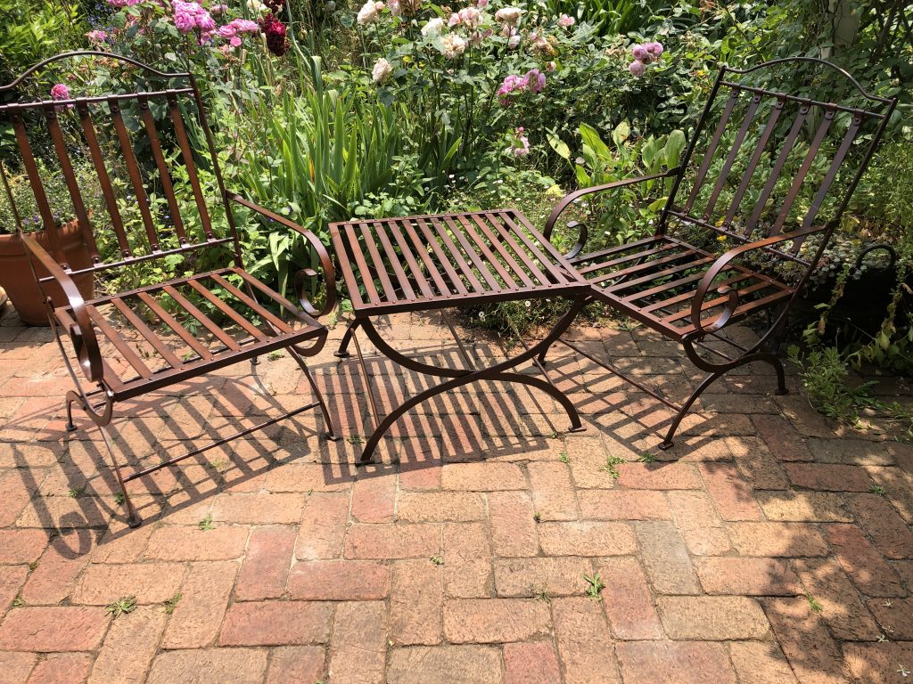 wrought iron chairs and side table