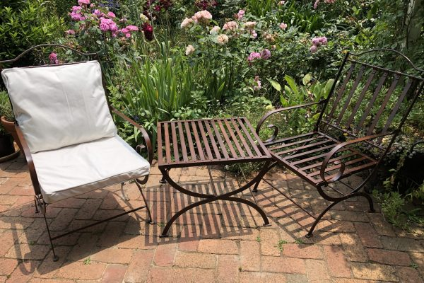 wrought iron chairs and table in a garden