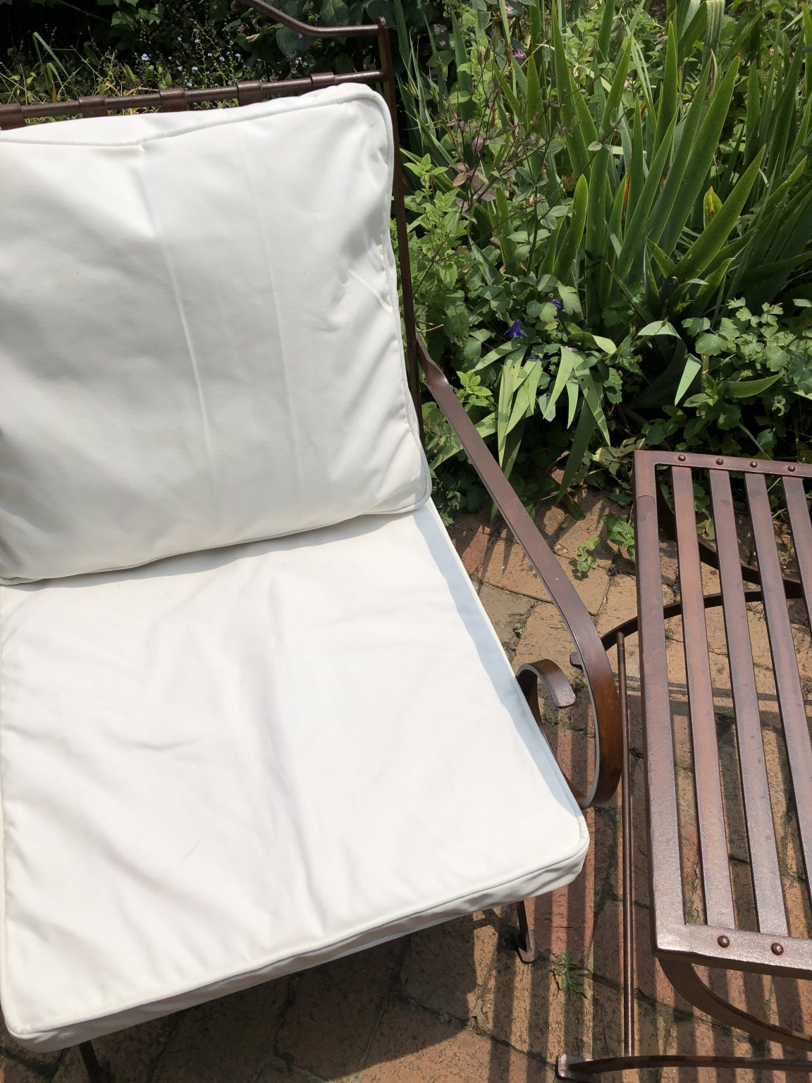 chair with cushions in a garden