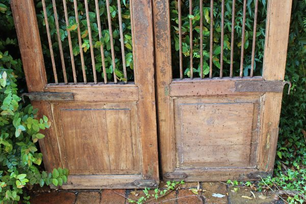 Timber gate with iron hinges