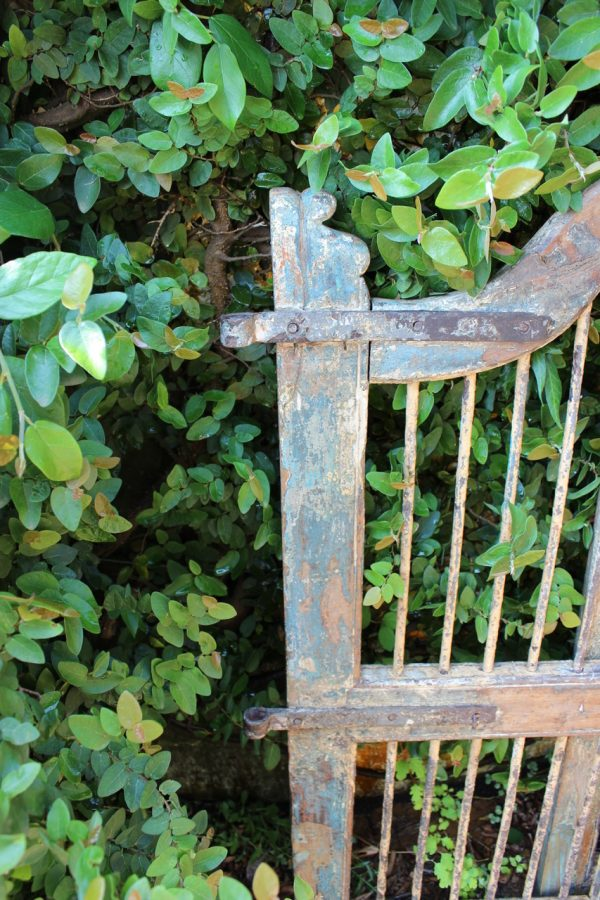 Timber gate with vertical iron bars