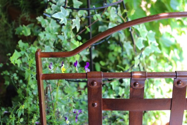 top corner of wrought iron chair