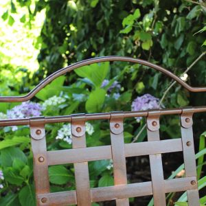Wrought iron chair & hydrangeas