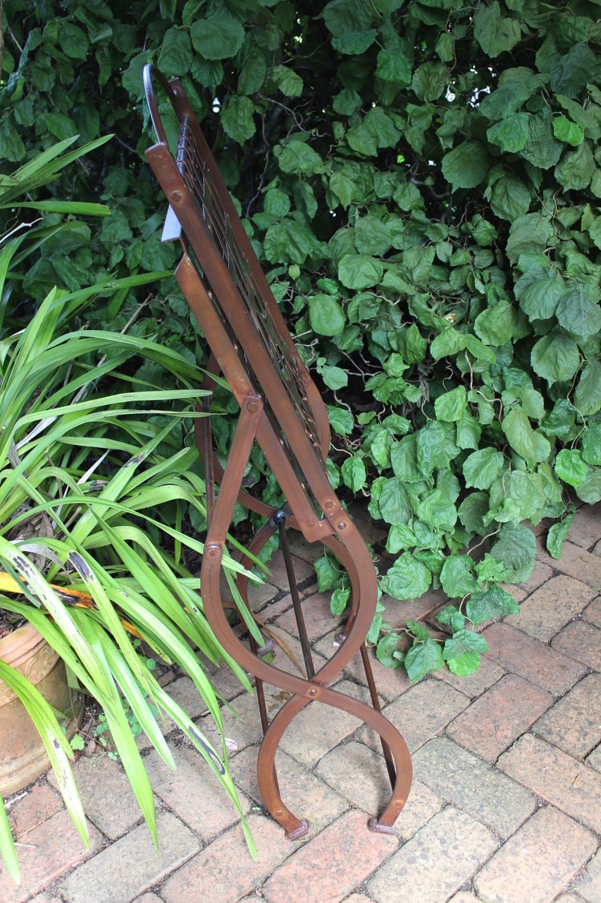 folded wrought iron chair