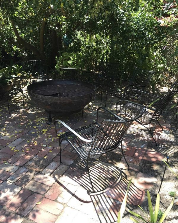 Garden chairs around a fire pit