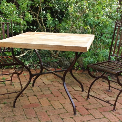Teak table top and iron base