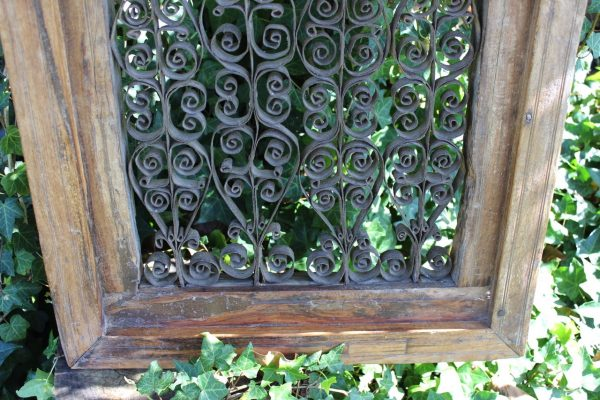 wrought iron scrollwork in a timber frame
