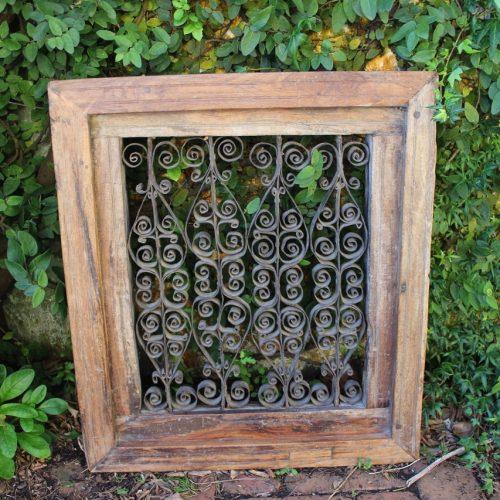 Metal scrollwork in timber frame