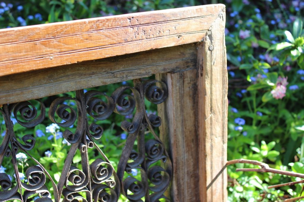 wrought iron scroll in timber frame