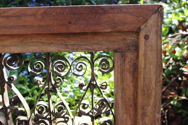 Metal scrollwork in a timber frame