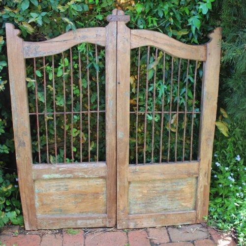 wooden gate with iron bars